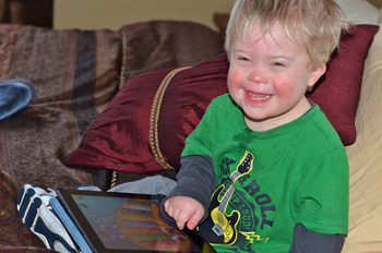 Little boy learning with the iPad.