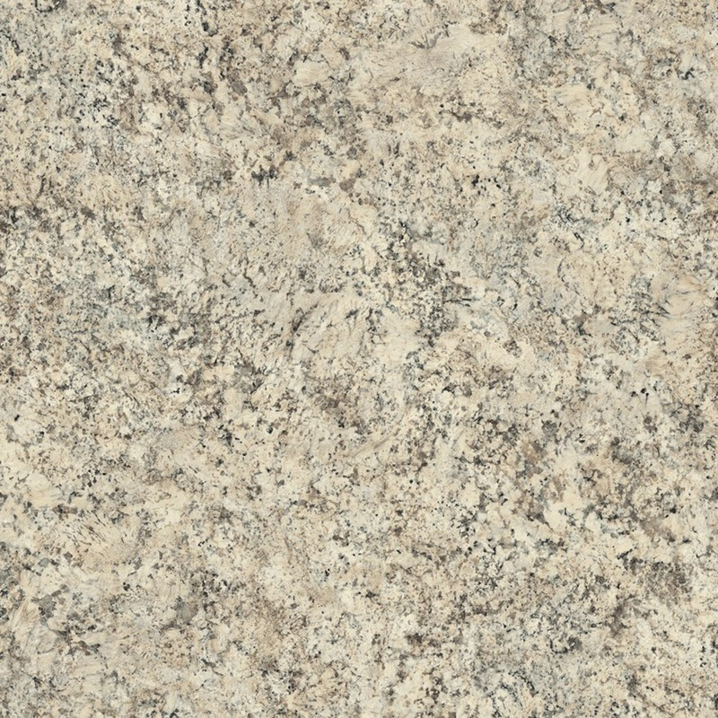 Large scale granite in a creamy white with black, cool white, and grey accents.