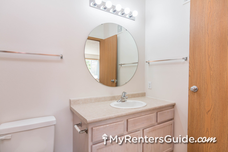 Bathrooms include decorative mirrors and lots of storage